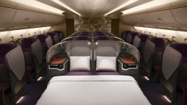 the-business-class-seats-along-the-center-of-the-aircraft-can-be-connected-to-form-a-single-bed-great-for-families-traveling-together-passengers-also-get-an-18-inch-entertainment-screen